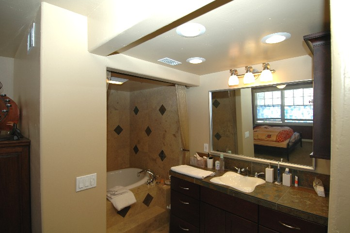 Stunning tile work in the romantic master suite bath...