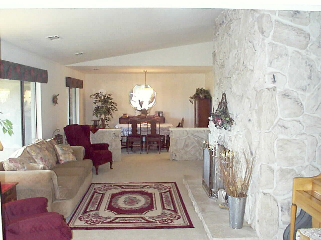 Formal Living Room and Dining Room with Elegant stone work and real Masonry Firplace.