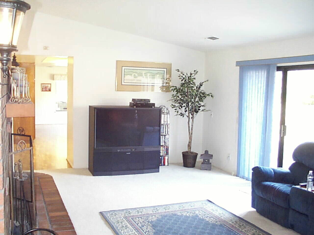 Spacious Family Room for any size entertainment center.. warmed by Masonry Brick Fireplace