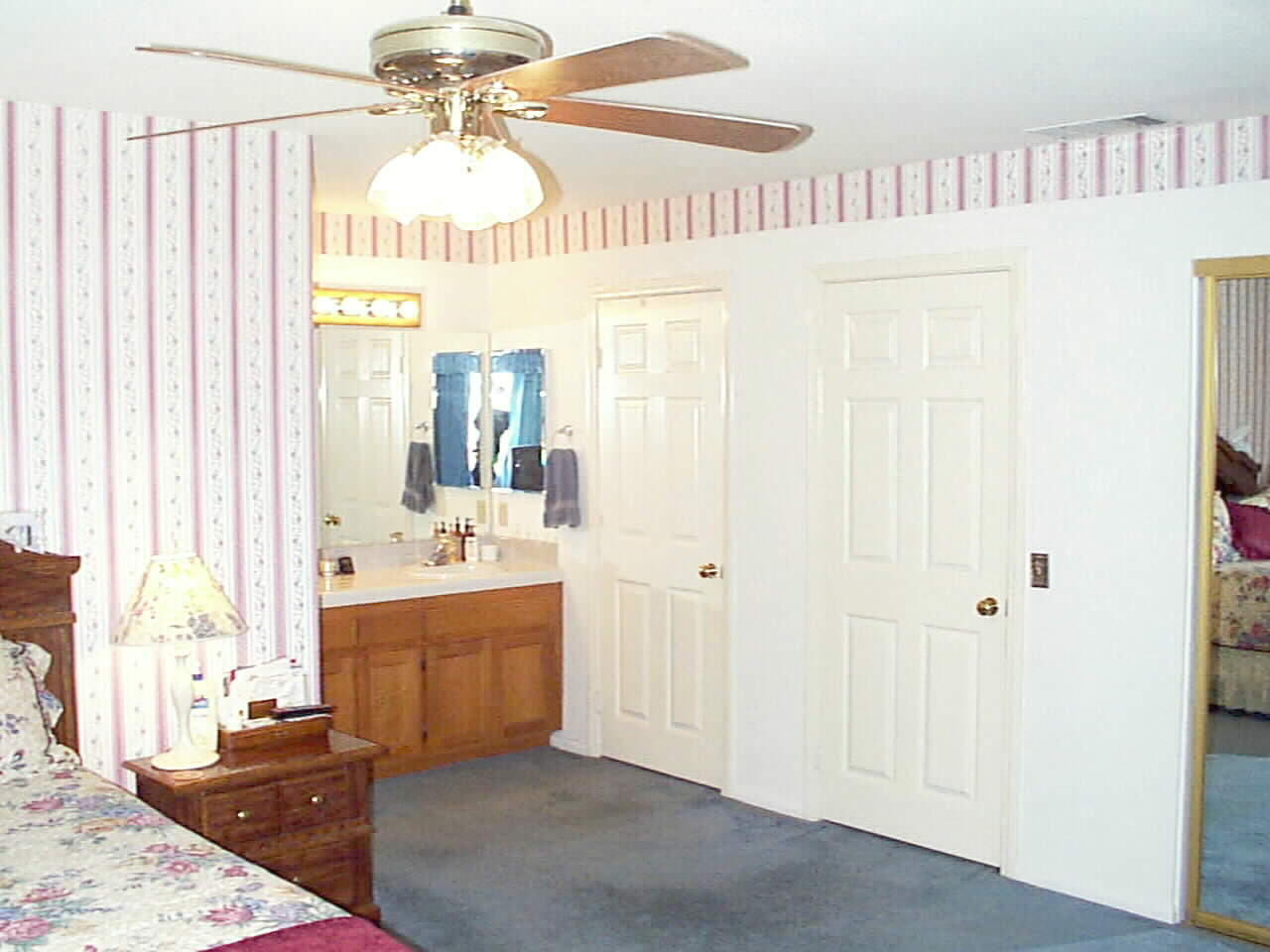 Private Master Suite with famous Her's and Her's Closet.. Storage Galore !