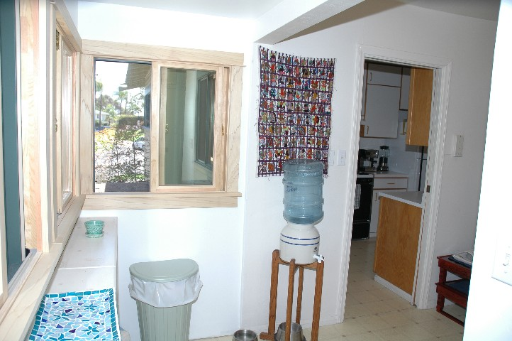Wonderful Mud Room enclosed back porch... picture the window frames stained and finished.