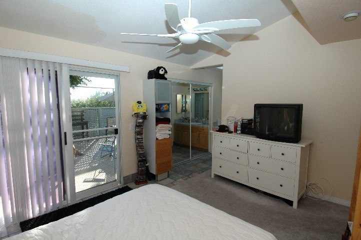 Spacious... Quiet... Private Master Suite with Sliding Door to Ocean Breezes